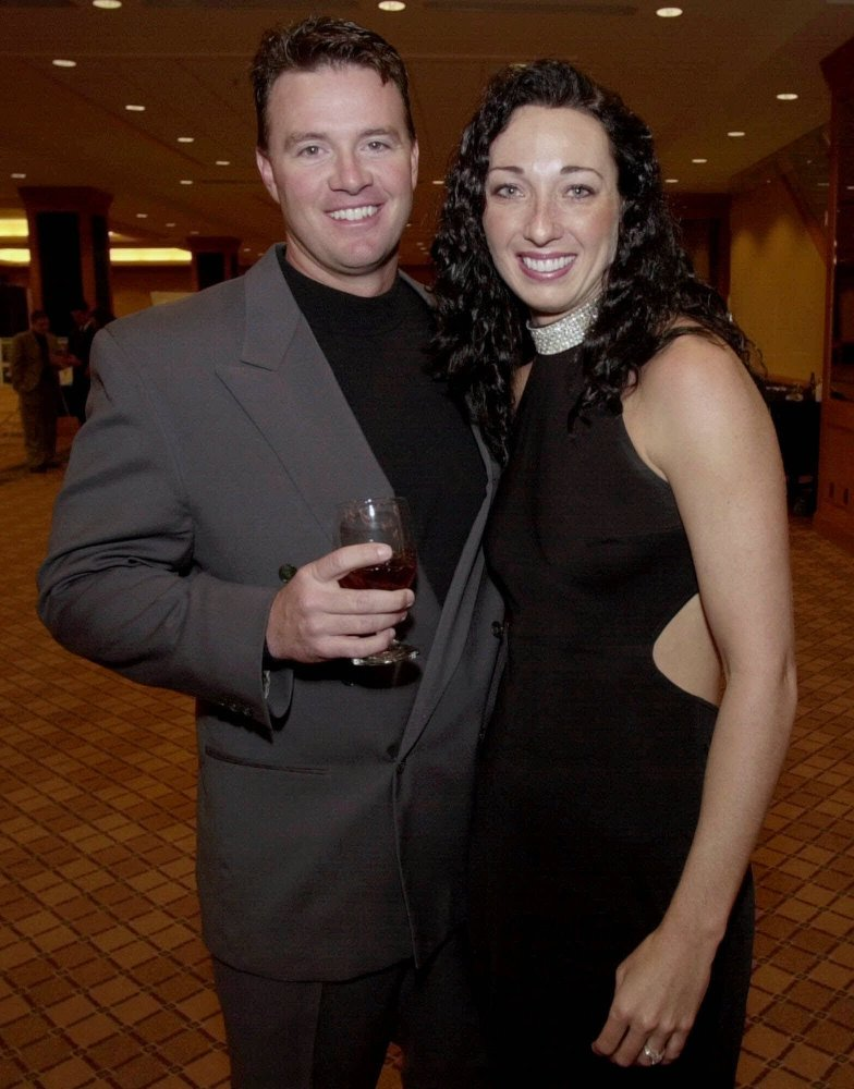 In this March 1, 2001 file photo, six-time Olympic gold medalist swimmer Amy Van Dyken, right, and Denver Broncos punter Tom Rouen pose before going into the Colorado Sports Hall of Fame dinner in Denver. The Associated Press/David Zalubowski