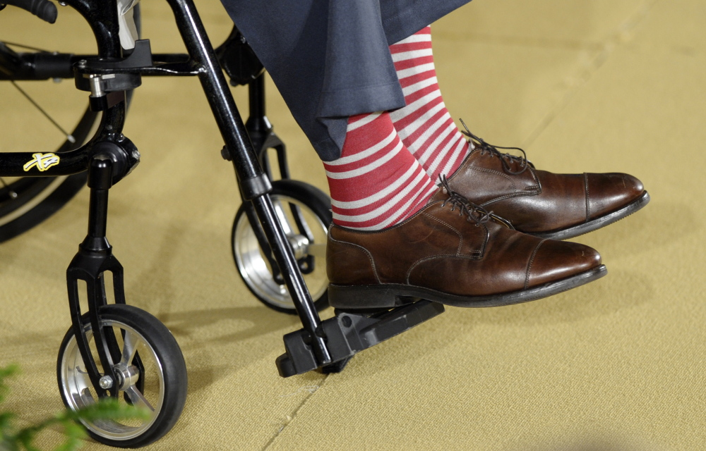 The Associated Press Former President George H.W. Bush wears a pair of striped socks to a ceremony for his Thousand Points of Light initiative in the East Room of the White House in this July 2013 photo.