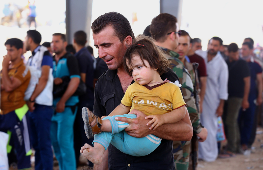 Refugees fleeing from Mosul head to the self-ruled northern Kurdish region in Irbil, Iraq, 217 miles north of Baghdad, on Tuesday. Islamic militants overran parts of Iraq's second-largest city of Mosul on Tuesday.