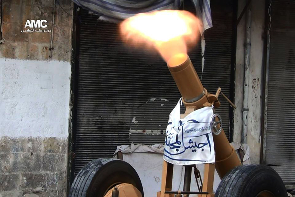 This photo provided by the anti-government activist group Aleppo Media Center (AMC), which has been authenticated based on its contents and other AP reporting, shows a locally made shell being fired by the Free Syrian Army towards Syrian government forces, in Aleppo, Syria, Tuesday June 10, 2014. Fighting in eastern Syria between the Islamic rebel brigades and an al-Qaida splinter group has killed more than 630 people and uprooted at least 130,000 since the end of April, an activist group said Tuesday. The Associated Press/Aleppo Media Center