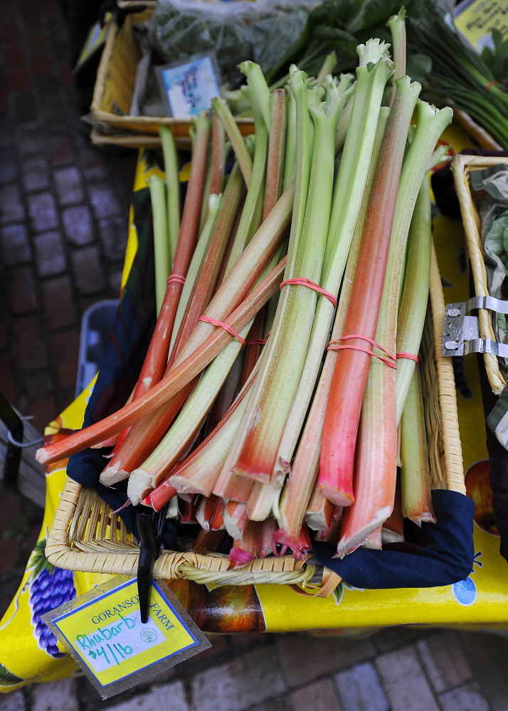 Rhubarb from Garanson Farm at the Portland Farmers Market. Cooks tired of pedestrian strawberry-rhubarb pie can take a page from local chefs, who are using rhubarb in everything from shortcakes to salsas and more. Staff photo by Gordon Chibroski