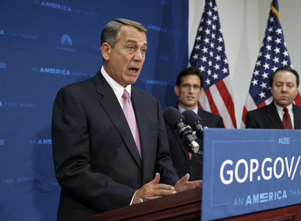House Speaker John Boehner of Ohio, joined by House Majority Leader Eric Cantor, R-Va., talks to reporters on Capitol Hill in Washington on Tuesday. The Associated Press