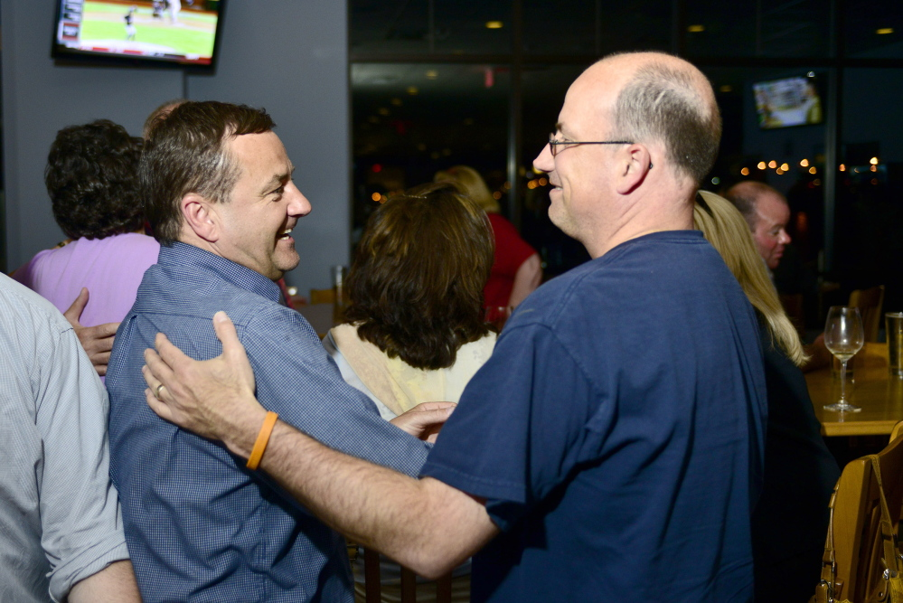 """Logan Werlinger/Staff Photographer Michael Edes talks with supporters during his primary party Tuesday night at Easy Day in South Portland. """"I'm getting ready for a good, long fishing trip,"""" Edes said."""