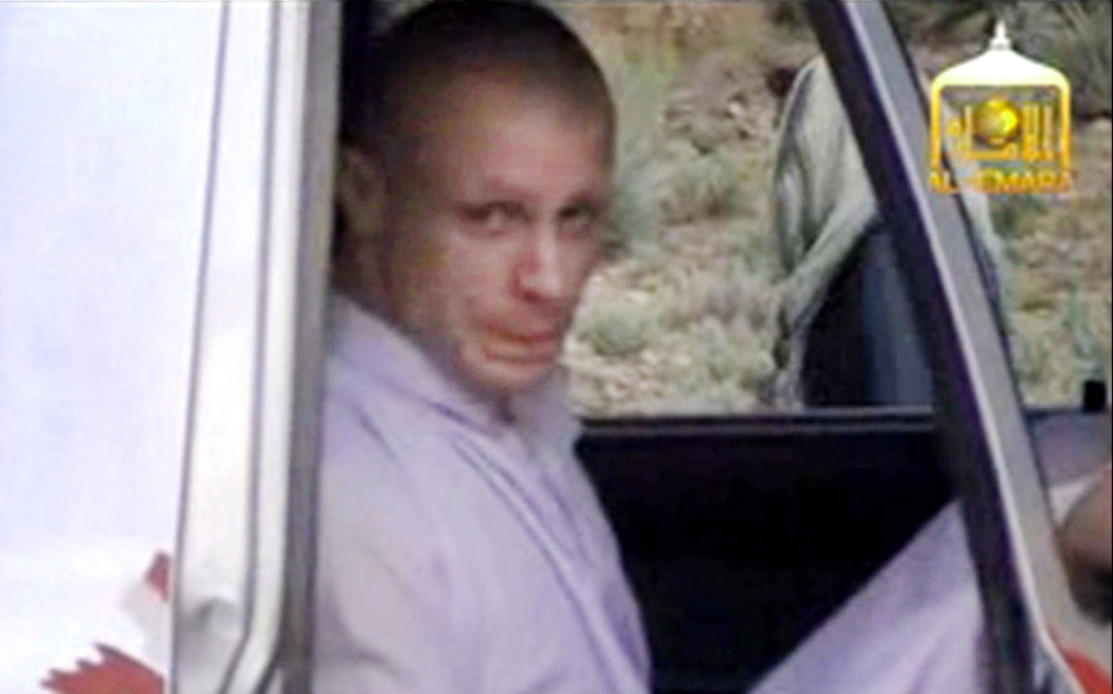 In this image taken from video obtained from Voice Of Jihad Website, which has been authenticated based on its contents and other AP reporting, Sgt. Bowe Bergdahl sits in a vehicle guarded by the Taliban in eastern Afghanistan. The Associated Press