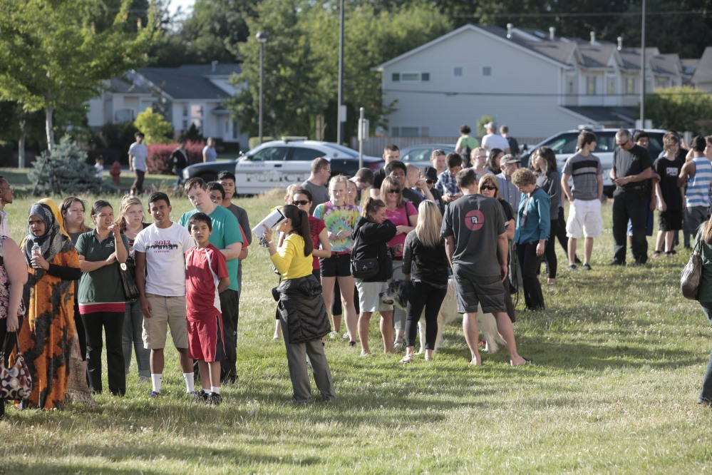 Students and family line up to receive personal property at the north gym of Reynolds Middle School on Tuesday evening, June 10, 2014. A teen gunman armed with a rifle shot and killed a 14-year-old student Tuesday and injured a teacher before he likely killed himself at a high school in a quiet Columbia River town in Oregon, authorities said. (AP Photo/The Oregonian, Michael Lloyd)