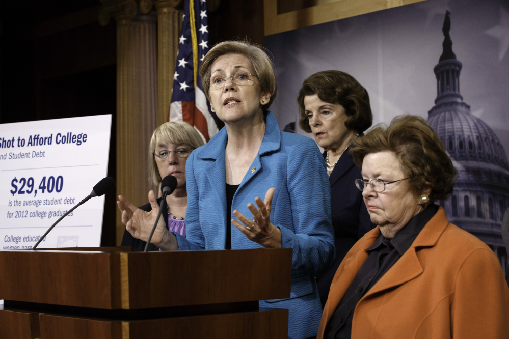 Sen. Elizabeth Warren, D-Mass., center, joined by other women of the Senate, holds a news conference on her bill, the Bank on Students Emergency Loan Refinancing Act, in this June 4, 2014, photo.