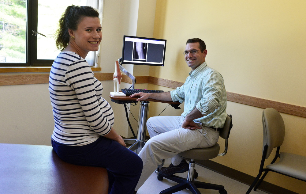 Dr. Brad Wagner, right, and Natalia Provencher are shown at the Intermed Family Medicine clinic in Portland on Friday. Intermed's addition of roughly 15 jobs during the past five years reflects a trend.