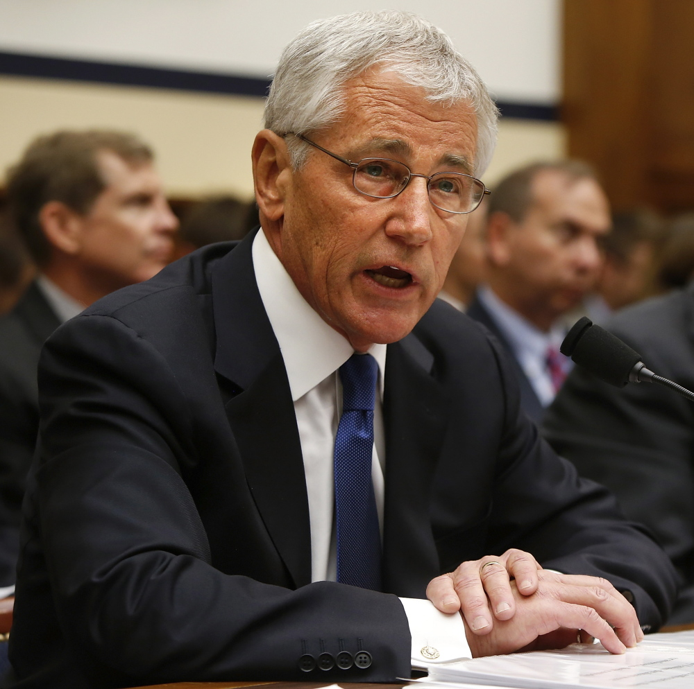Defense Secretary Chuck Hagel defends the Bergdahl prisoner exchange decision Tuesday on Capitol Hill.