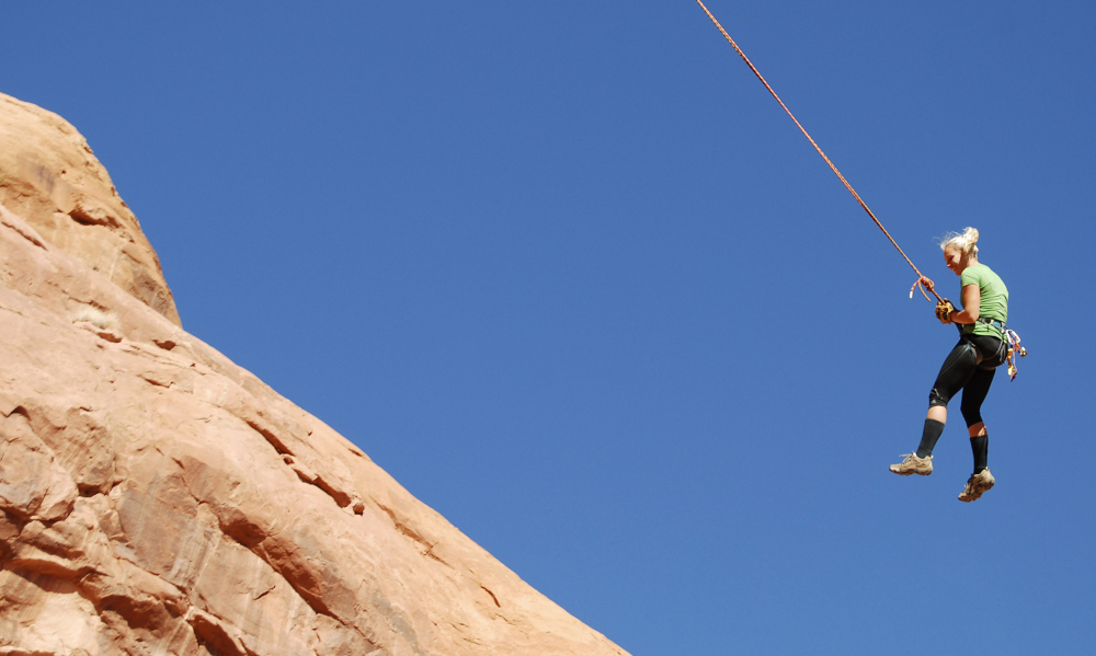 Corona Arch is popular for daredevil rope-swinging. Federal officials are considering outlawing the stunt.
