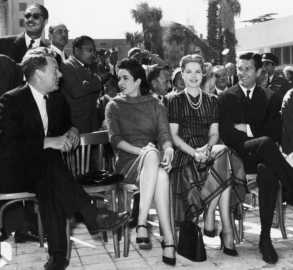 Hollywood screen actors, from left, Van Johnson, Linda Cristal, Martha Hyer, and Hugh O'Brian share attention in 1959. Hyer, who gained fame for starring roles alongside Frank Sinatra and Humphrey Bogart, was also known for her lavish lifestyle. She died May 31 in Santa Fe, N.M.
