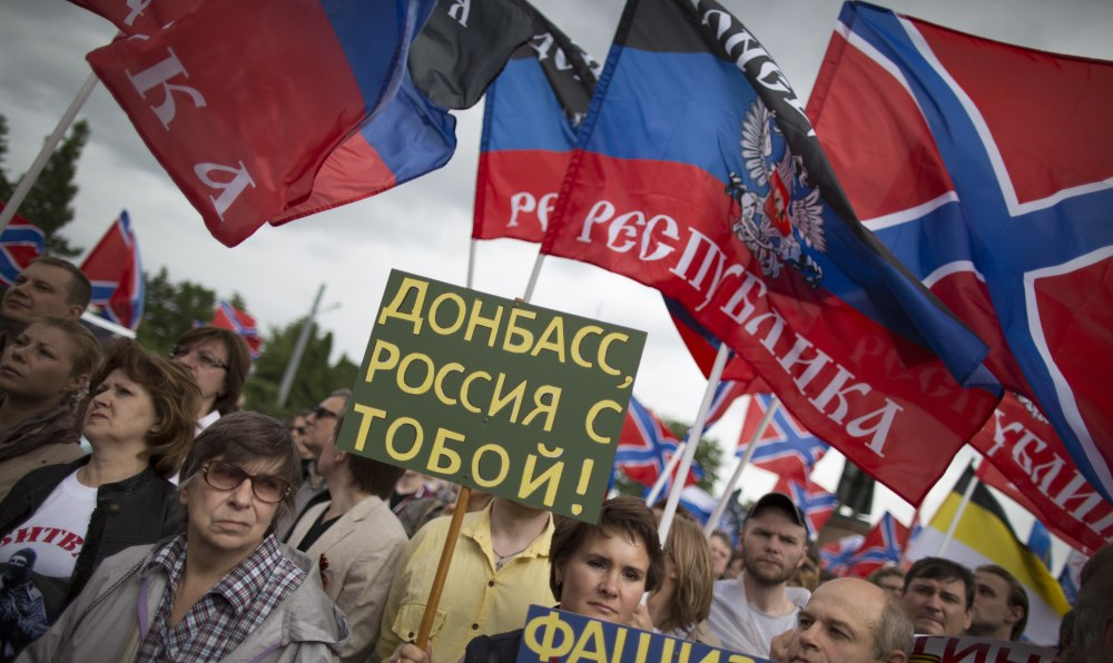 People attend a rally for the pro-Russian Donetsk Peoples Republic in Moscow on Wednesday. Russia is supplying humanitarian aid to eastern Ukraine with the aid of militia.