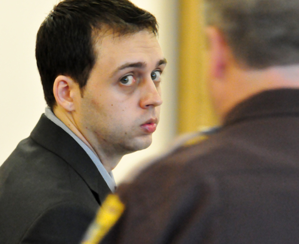 Roland Dow sits in court during a break in his trial Thursday in Brentwood, N.H. Dow is accused of beating and burning his former girlfriend's 3-year-old son.