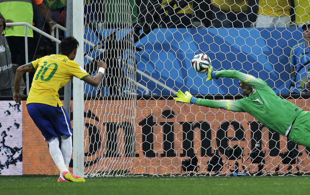 Brazil's Neymar, left, scores his sides second goal from the penalty spot during the group A World Cup soccer match between Brazil and Croatia, the opening game of the tournament, in the Itaquerao Stadium in Sao Paulo, Brazil, Thursday, June 12, 2014.