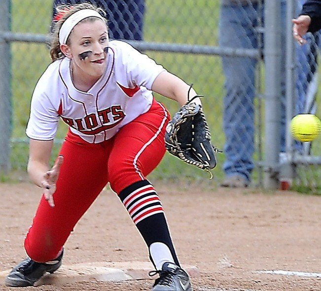 South Portland first baseman Michaela Willwerth takes the throw from home plate to retire Bonny Eagle's Kelsy Gaddy on a bunt attempt.