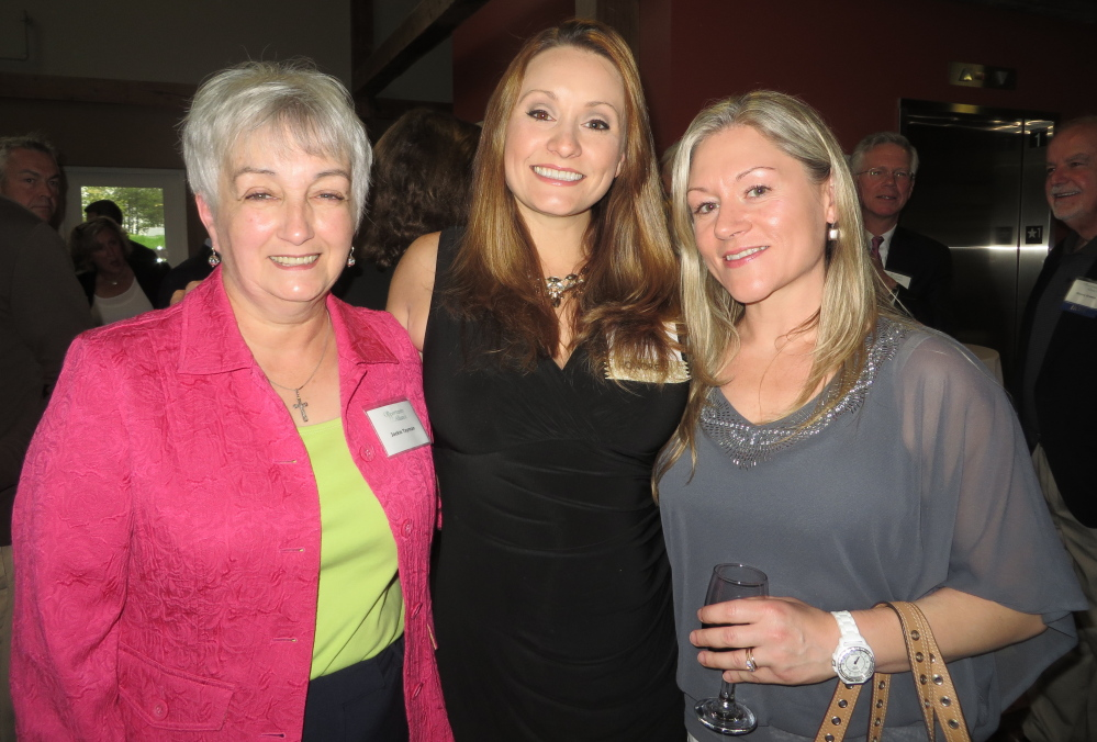 """Cynthia Veroneau of South Portland, center, who was honored as Volunteer of the Year for Opportunity Alliance, with her mother Jackie Tayman, left, and her friend Amy Bois. Veroneau says volunteering with the organization involves """"putting clothes on the poor, feeding the hungry, giving people a place to sleep."""""""