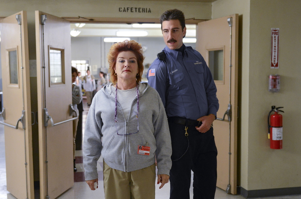 """Kate Mulgrew, left, as Galina """"Red"""" Reznikov and Pablo Schreiber as George """"Pornstache"""" Mendez in """"Orange Is the New Black."""" The second season of the Netflix series is now available for streaming."""