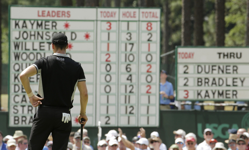 Martin Kaymer, of Germany, looks at his name on top of the leaderboard on the second hole during the second round of the U.S. Open golf tournament in Pinehurst, N.C., Friday, June 13, 2014.