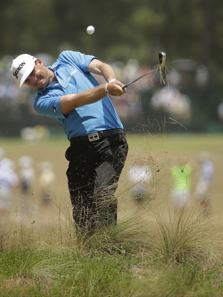 Keegan Bradley hits from the natural area on the eighth hole during the second round of the U.S. Open golf tournament in Pinehurst, N.C., Friday, June 13, 2014.
