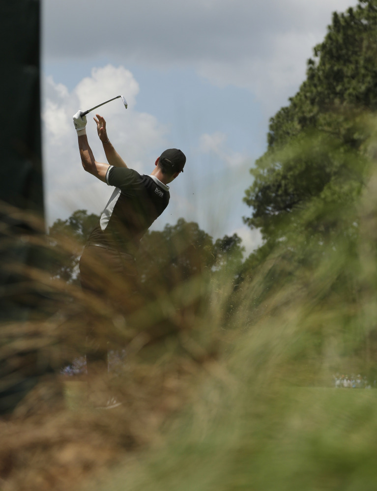 Martin Kaymer, of Germany, watches his tee shot on the sixth hole during the second round of the U.S. Open golf tournament in Pinehurst, N.C., Friday, June 13, 2014.