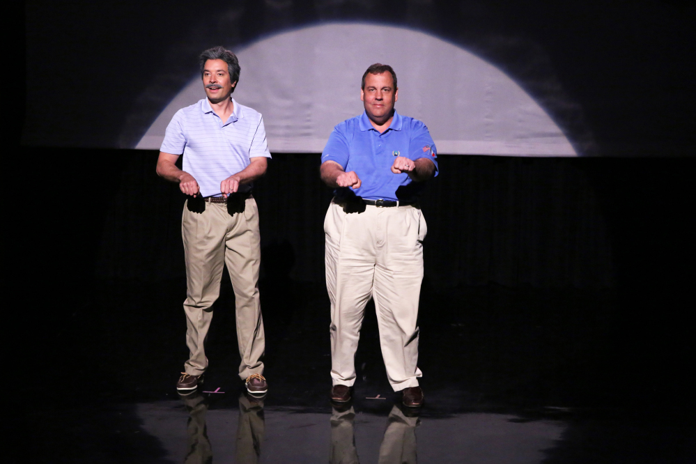 """This Thursday, June 12, 2014 photo shows host Jimmy Fallon, left, and Gov. Chris Christie during the """"Evolution of Dad Dancing"""" skit on """"The Tonight Show Starring Jimmy Fallon."""""""