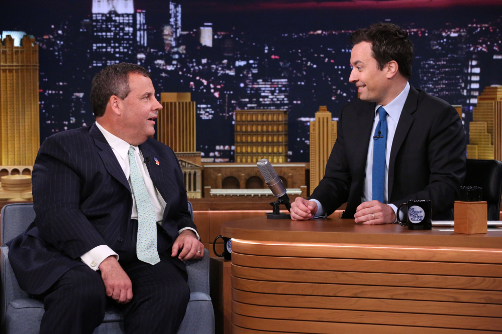 """This Thursday, June 12, 2014, photo provided by NBC shows Gov. Chris Christie, left, during an interview on """"The Tonight Show Starring Jimmy Fallon."""" During his appearance, Christie was asked whether, """"hypothetically,"""" he thinks he could beat Democrat Hillary Clinton in a one-on-one matchup. """"Hypothetically? You bet,"""" he said."""