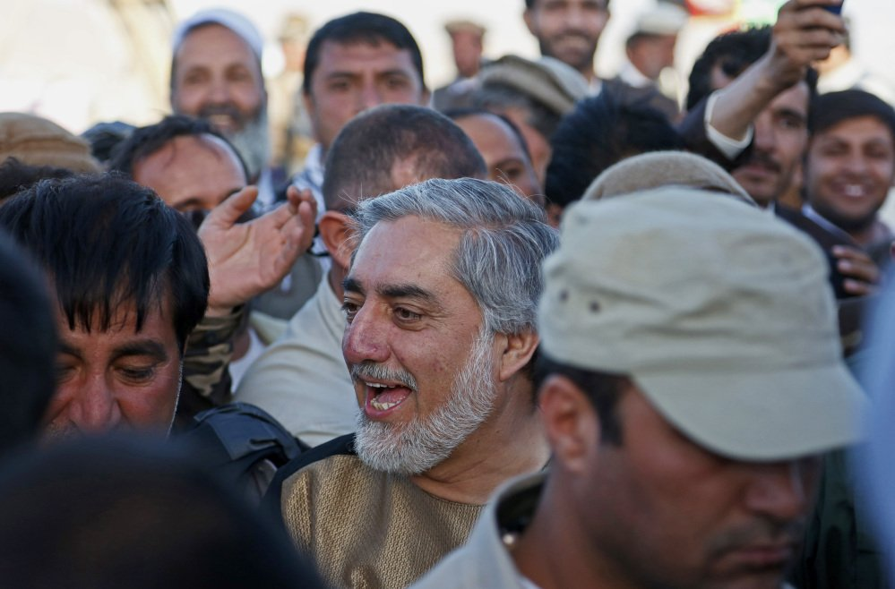 In this photo taken Monday, June 9, 2014, Afghanistan presidential candidate Abdullah Abdullah greets with his supporters during a campaign rally in the Paghman district of Kabul, Afghanistan. With fears of violence high, Afghanistan braced for a final election on Saturday to choose a new president to replace the only leader the nation has known since the Taliban were ousted and guide the transition to a country that will have to wean itself off near-total dependence on international aid after foreign combat troops withdraw at the end of this year. (AP Photo/Rahmat Gul)