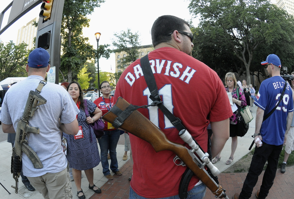 Participants in an Open Carry rally at the Fort Worth Convention Center in Fort Worth, Texas, on June 5 advocate for the right to bear arms in public.