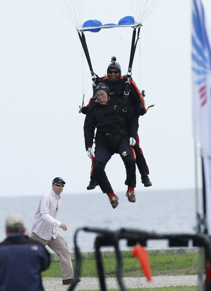 Mike Elliott and former President George H.W. Bush prepare to touch down Thursday in Kennebunkport.