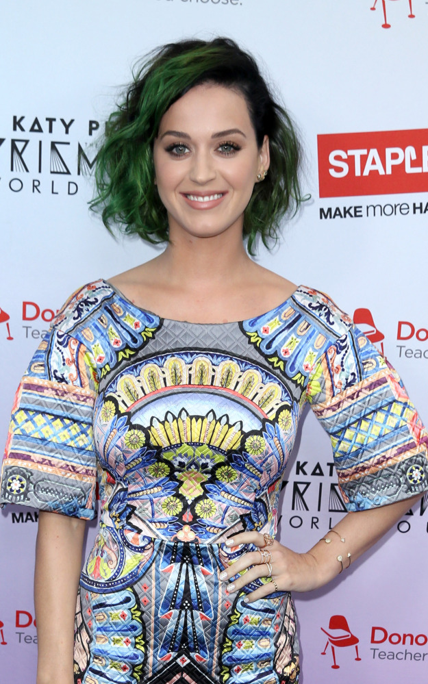 """Katy Perry poses for a photo at the Staples """"Make Roar Happen"""" news conference Thursday at the Nokia Theatre in Los Angeles."""