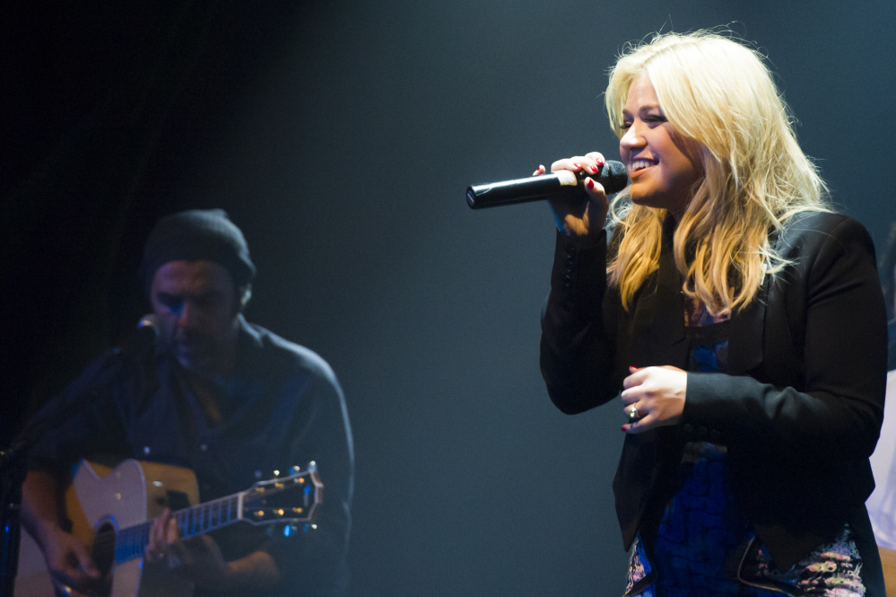 """Kelly Clarkson, shown performing in October 2013, performs at Green Mountain Coffee's """"Great Coffee, Good Vibes, Choose Fair Trade"""" campaign concert in New York. The Grammy winner announced the birth of her daughter in on Saturday on Twitter"""