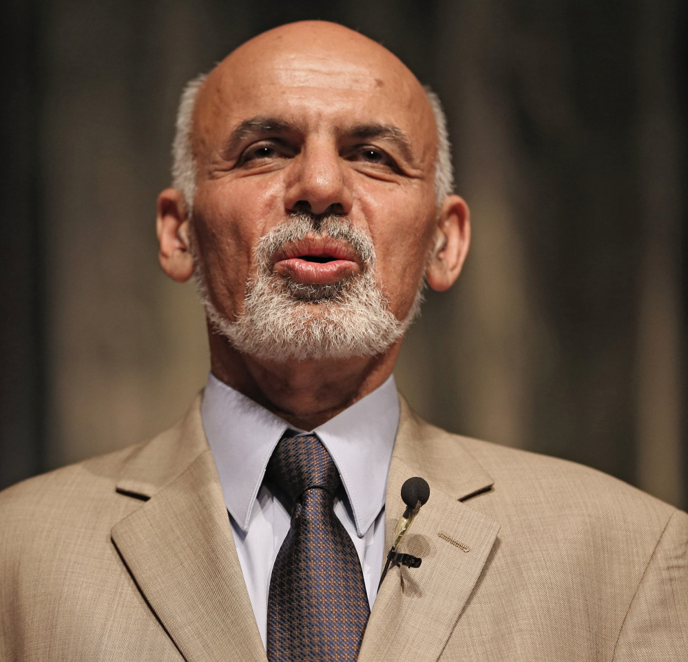 Afghanistan's presidential candidates are Abdullah Abdullah, at left, and Ashraf Ghani, above.