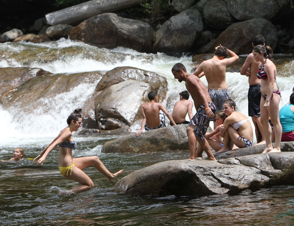 People enjoy the Lower Falls of the Swift River in Albany, N.H., in 2012. The popular spot will be closed for safety and other improvements during the summer and fall of 2014.