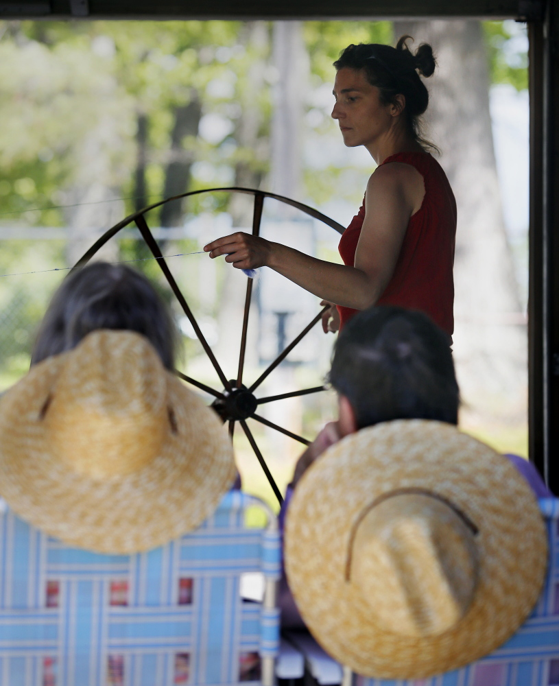 Trina Graybill of Skowhegan demonstrates how to use an antique walking wheel to spin wool. Derek Davis/Staff Photographer