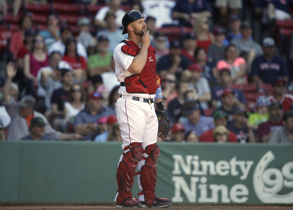 Boston Red Sox catcher David Ross watches as Cleveland Indians' Nick Swisher rounds the bases after hitting a home run in the 11th inning Sunday.