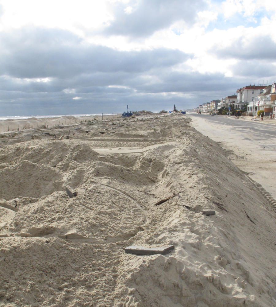 This Nov. 15, 2012 photo shows a pile of sand where the Belmar, N.J., boardwalk had been before Superstorm Sandy. On Monday, the Department of the Interior awarded 11 states $102 million in grants to protect against future storms.