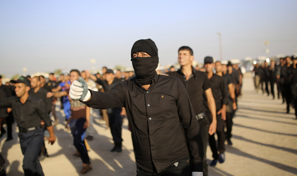Mehdi Army fighters loyal to Shiite cleric Moqtada al-Sadr march Monday during a military-style training in the holy city of Najaf. The U.S. said it could launch airstrikes and act jointly with its arch-enemy Iran to support the Iraqi government against Sunni Islamic insurgents.