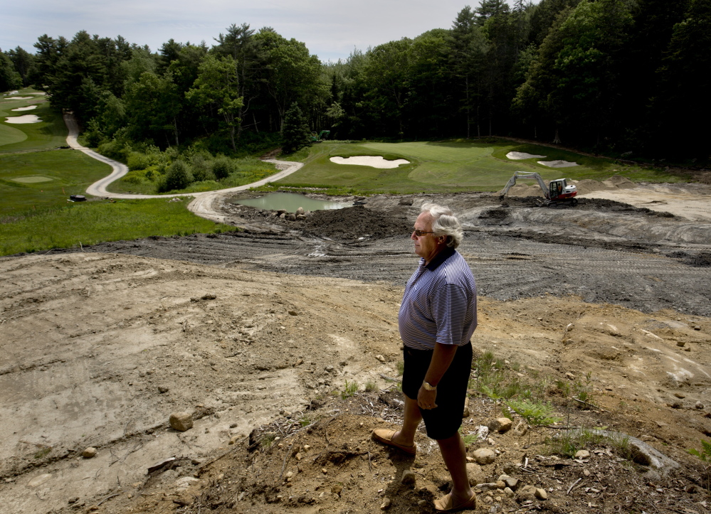 Paul Coulombe, owner of the Boothbay Harbor Country Club, stands on the edge of a construction zone on his golf course Wednesday. Coulombe is using his own funds to completely renovate the property.