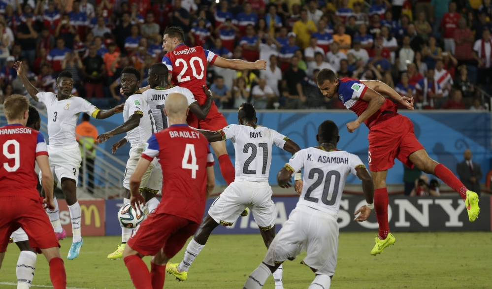 United States' John Brooks, right, heads the ball to score his side's second goal during the group G World Cup soccer match between Ghana and the United States.
