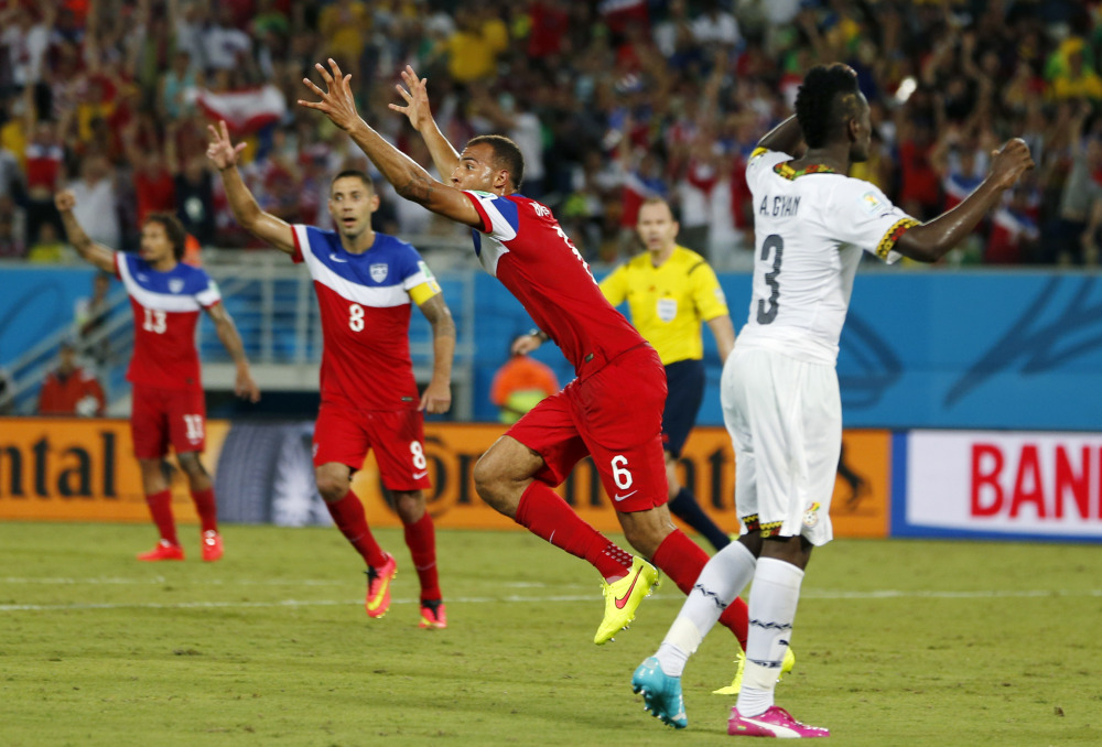 United States' John Brooks (6) celebrates with teammates after scoring his side's second goal during the group G World Cup soccer match between Ghana and the United States in Natal, Brazil, Monday, June 16, 2014.