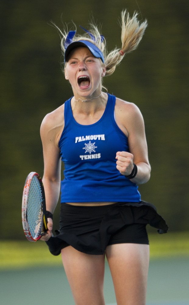Falmouth's Olivia Leavitt celebrates after defeating Brunswick's Masie Silverman during the Class A tennis state championships Monday in Lewiston.
