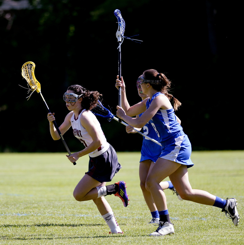 Freeport's Lily Johnston drives down field with the ball in girls lacrosse action against Morse Monday, June 16, 2014. Shawn Patrick Ouellette/Staff Photographer