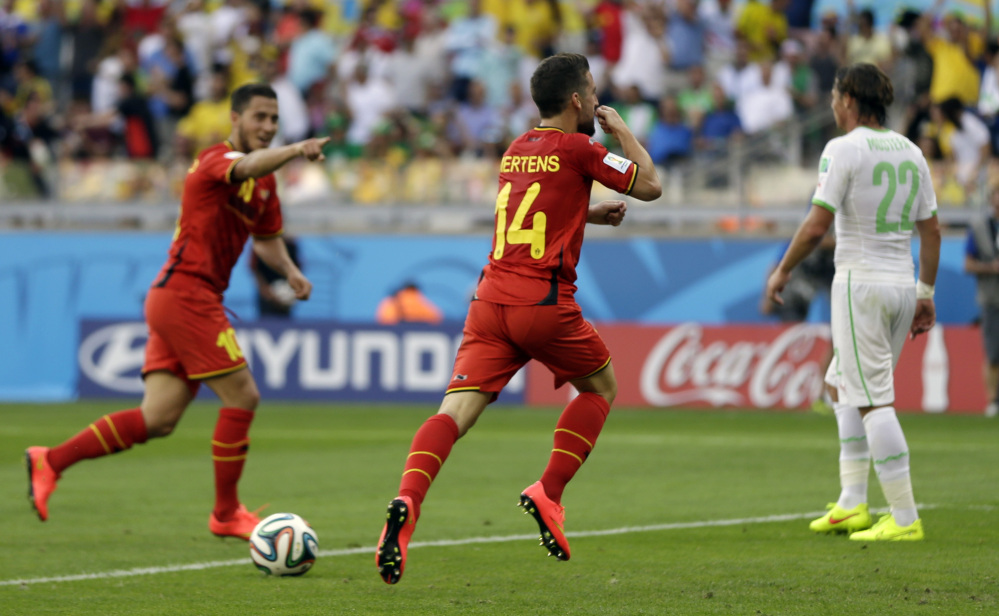 Belgium's Dries Mertens, center, celebrates after scoring his side's second goal during the group H World Cup soccer match between Belgium and Algeria in Belo Horizonte, Brazil, on Tuesday.