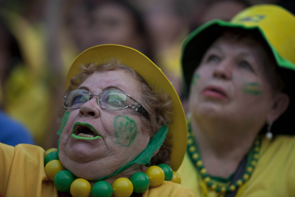 A fan of the Brazilian national soccer team watches the Mexico vs. Brazil match at the FIFA Fan Fest. Mexico claimed a well-deserved point against Brazil in a largely frustrating Group A game which finished 0-0 at Estadio Castelao in Fortaleza.