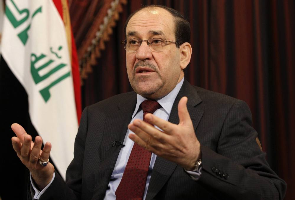 This December 2011 file photo shows Iraq's Shiite Prime Minister Nouri al-Maliki talks during an interview with The Associated Press in Baghdad, Iraq. Lawmakers who eagerly voted to authorize military force 12 years ago to oust Saddam Hussein and destroy weapons of mass destruction that were never found now harbor doubts that air strikes will turn back insurgents threatening Prime Minister Nouri al-Maliki's government and Baghdad.
