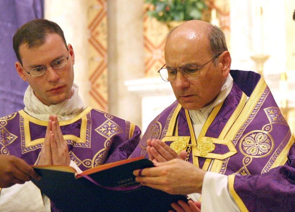 The Associated Press In this undated file photo provided by The Catholic Sun, the Rev. Kenneth Walker, left, and the Rev. Joseph Terra perform a Mass in Phoenix.
