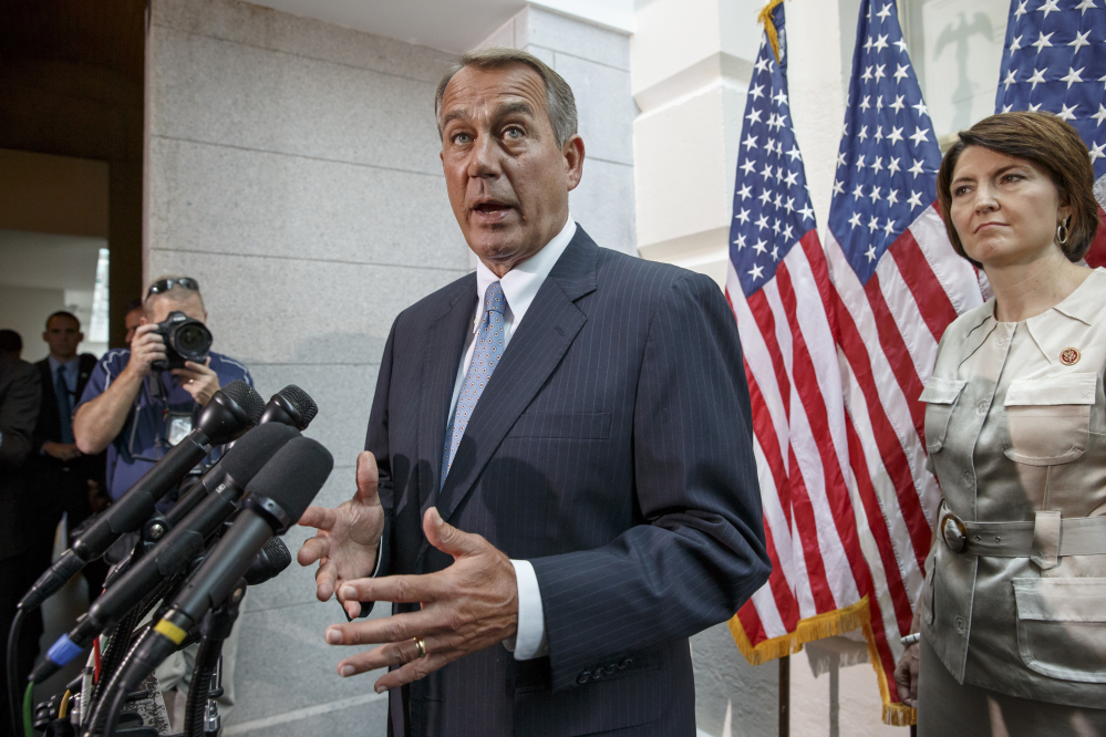House Speaker John Boehner of Ohio, accompanied by Rep. Cathy McMorris Rodgers, R-Wash., tells reporters on Capitol Hill in Washington on Wednesday that the United States should not be talking to Iran about a joint effort to help the Iraqi government battle insurgents.