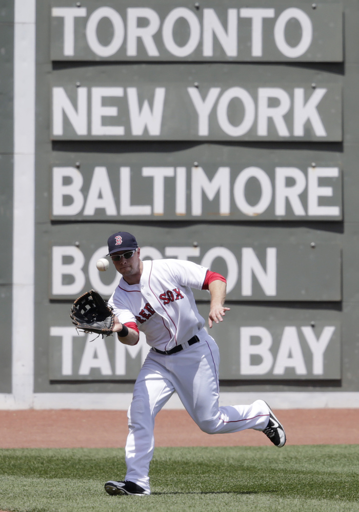 Boston Red Sox left fielder Daniel Nava makes the catch on a fly out by Minnesota Twins' Joe Mauer during the first inning of a baseball game at Fenway Park in Boston on Wednesday.