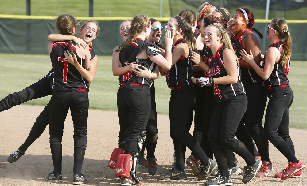 Wells High School players celebrate after defeating Cape Elizabeth High School during their Western Class B championship softball game at Saint Joseph's College in Standish on Wednesday.