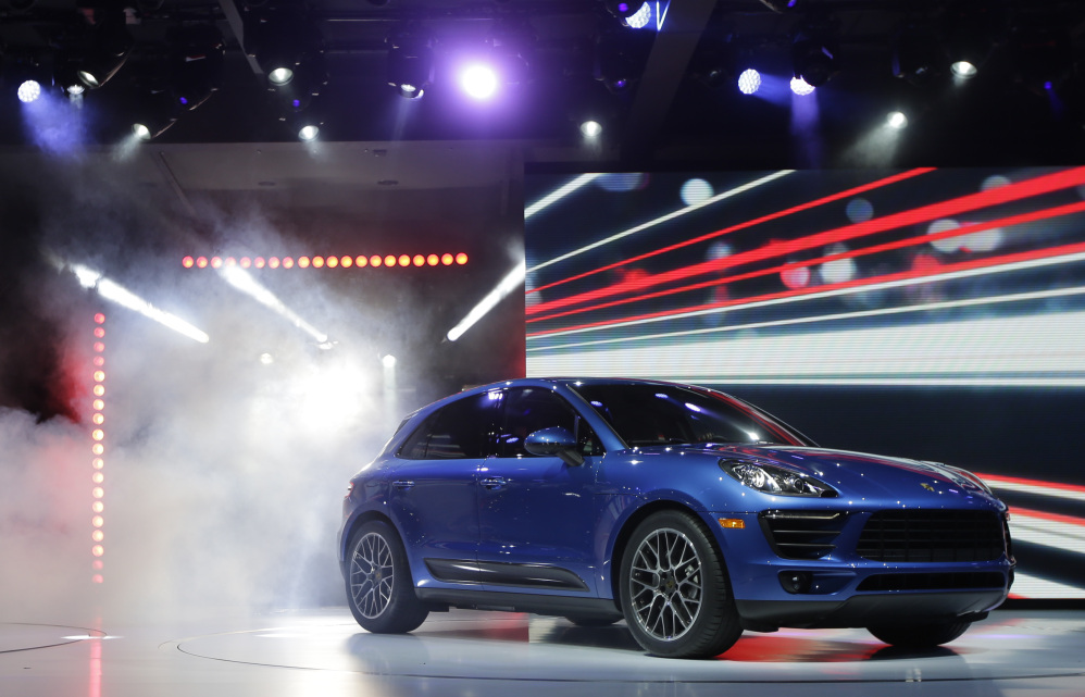 In this November 2013 file photo, the new Porsche Macan S is introduced at the Los Angeles Auto Show.