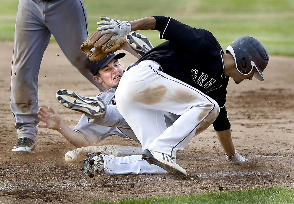 Miles Shields, foreground, of Greely collides with Lincoln Academy pitcher Sawyer Pinkham, who was covering first base on a grounder Wednesday during their Western Class B championship game. Shields was called out. Greely won 3-0 and will take on Caribou for the state title Saturday.
